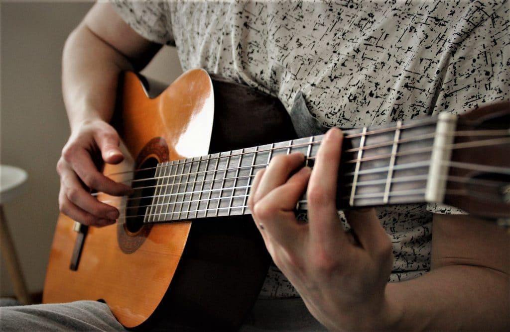 Guitarist plays classical nylon-string guitar