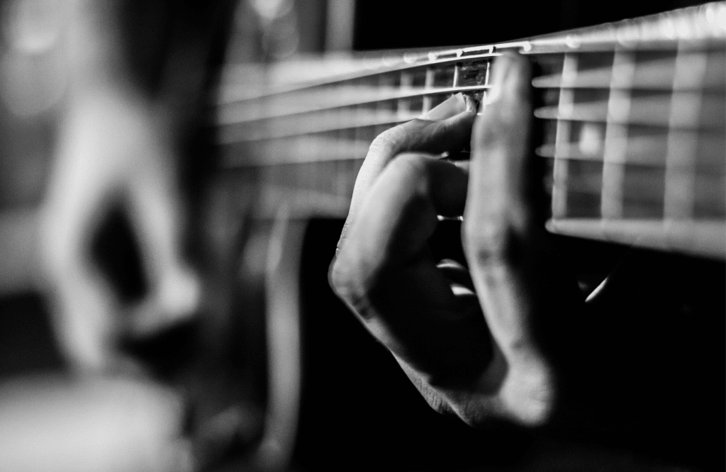 A Guitarist playing an classical acoustic guitar.