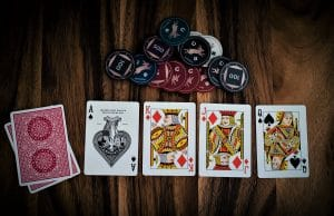 playing cards and chips have something to do with the guitar called an axe