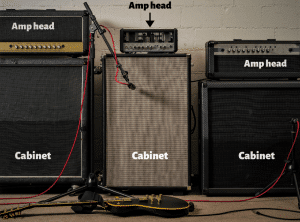 Photo helps readers to see how guitar amp heads and guitar cabinets look