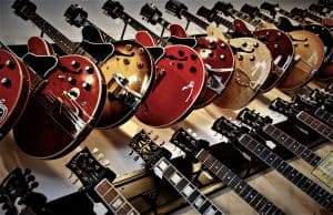 Photo shows readers multiple guitars hanged on to the wall