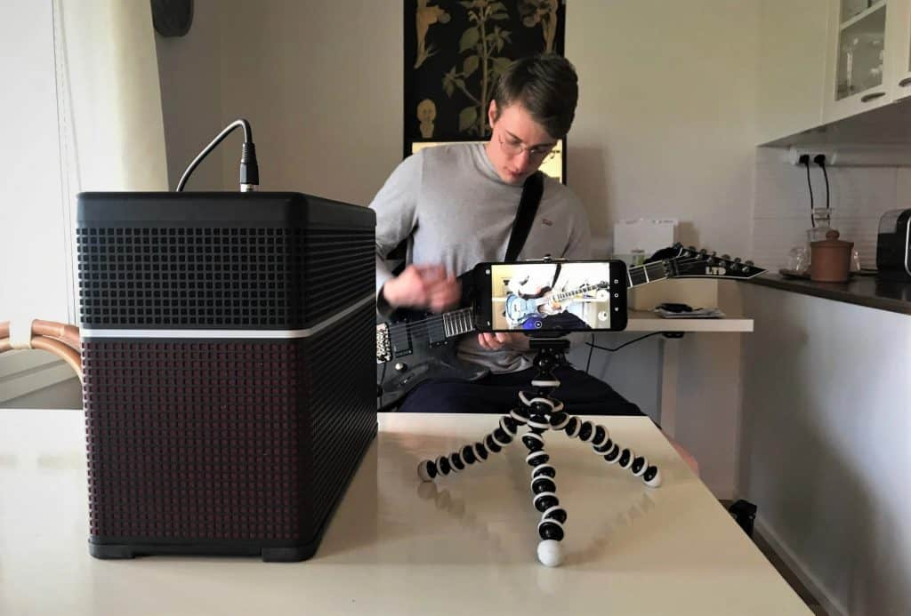 Photo shows readers how to setup their amp and phone when recording guitar playing