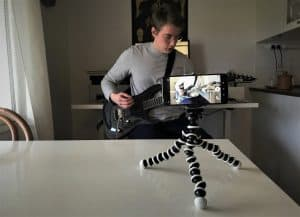 Photo shows readers how to setup their phone when filming guitar playing