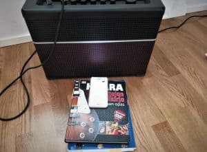 Photo shows readers how to setup their phone and amplifier when recording guitar playing