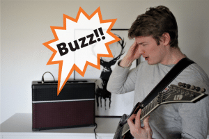 Photo shows people a guitar amp and a guitar player.