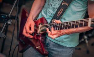 Guitar player playing gibson explorer