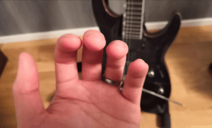 use your fingertips when playing the guitar