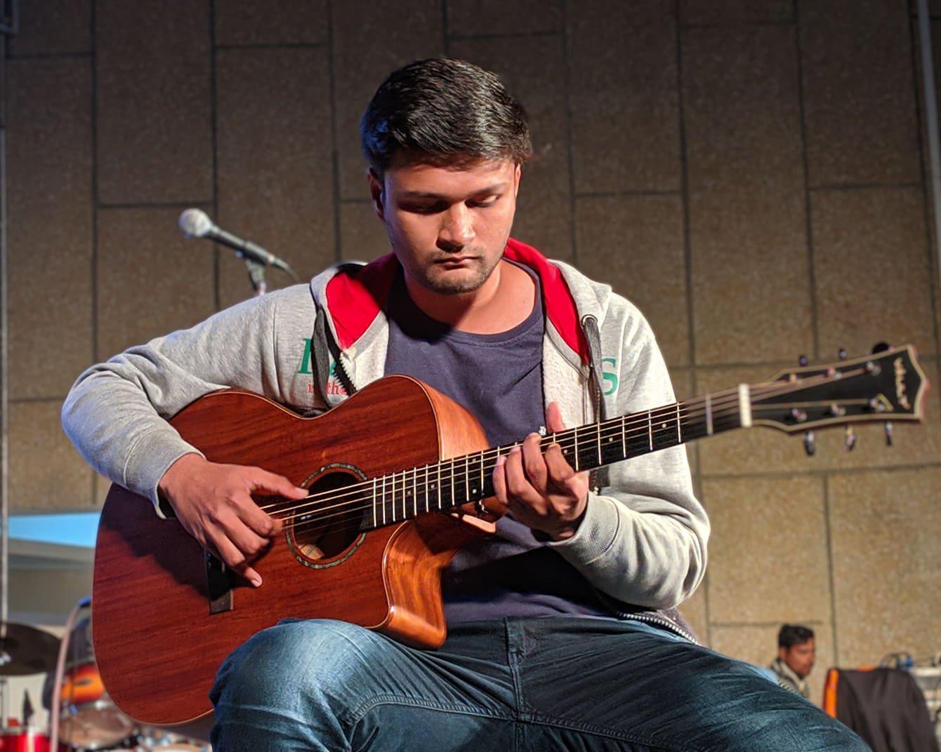 photo displays Pranshu, who works as a writer at guitaristnextdoor.com