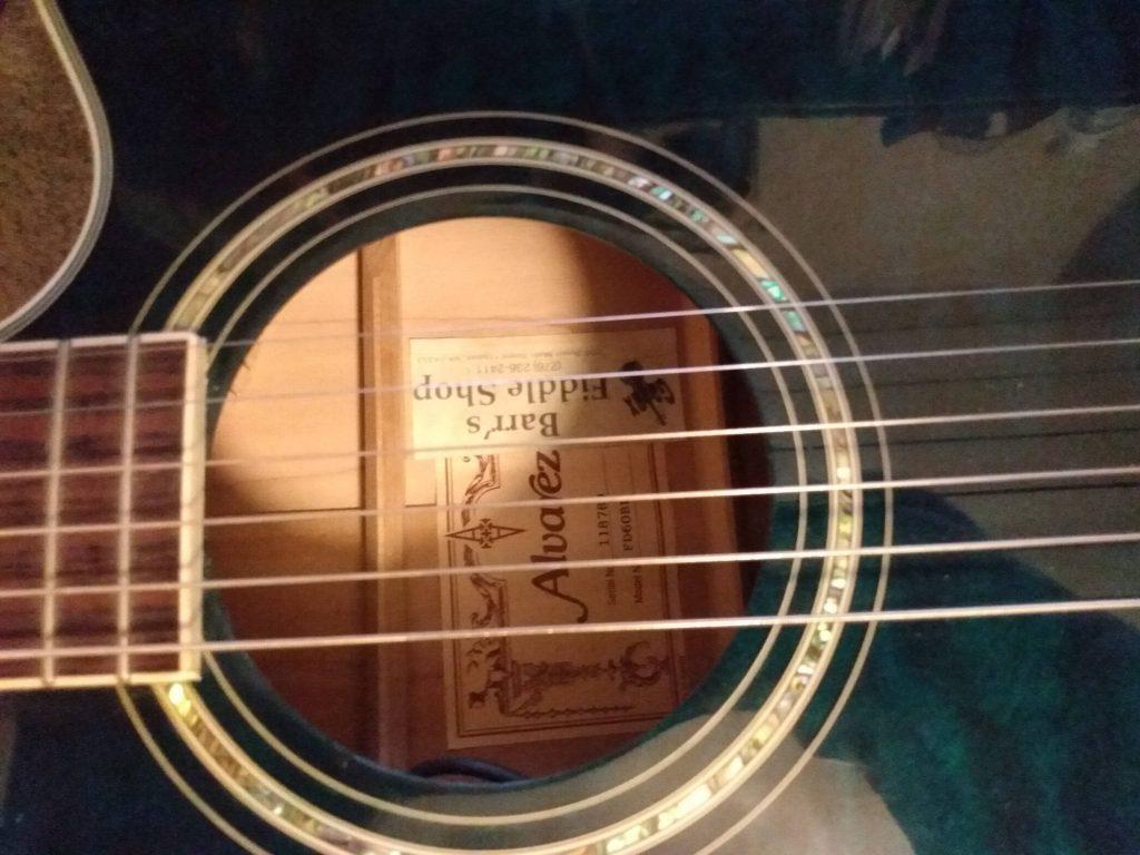 photo reveals acoustic guitar sound hole